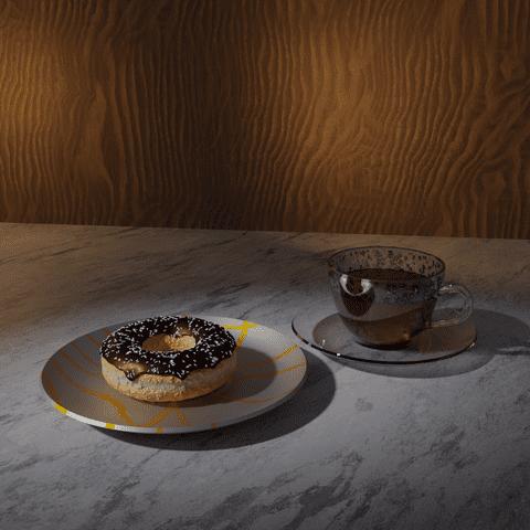 كوب شاي وكعك الدونت